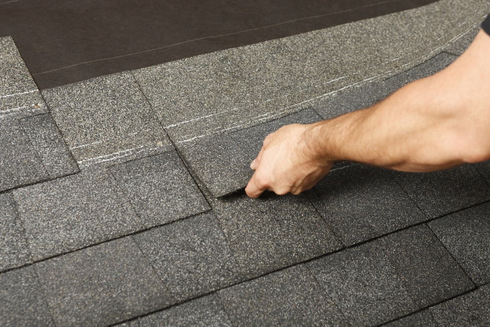 replacing shingles on a roof
